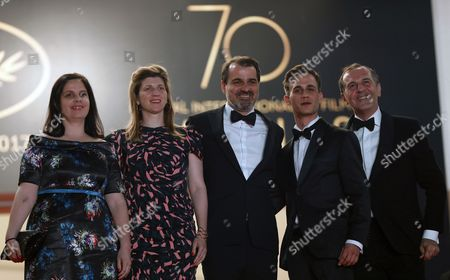 (R-L) Producer Viktoria Petranyi, Screenwriter Kata Weber, Hungarian director Kornel Mundruczo,  Hungarian actor Zsombor Jeger and actor Merab Ninidze arrive for the premiere of 'Jupiter's Moon' during the 70th annual Cannes Film Festival, in Cannes, France, 19 May 2017. The movie is presented in the Official Competition of the festival which runs from 17 to 28 May.