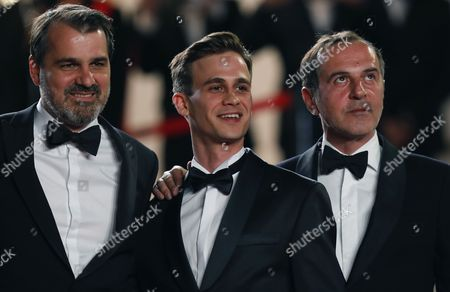 (R-L) Hungarian director Kornel Mundruczo,  Hungarian actor Zsombor Jeger and actor Merab Ninidze arrive for the premiere of 'Jupiter's Moon' during the 70th annual Cannes Film Festival, in Cannes, France, 19 May 2017. The movie is presented in the Official Competition of the festival which runs from 17 to 28 May.