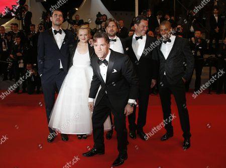 (R-L) Actor Christopher Laesso, British actor Dominic West, Swedish director Ruben Ostlund, US actress Elisabeth Moss, Dannish actor Claes Bang and US actor Terry Notary (C) arrive for the premiere of 'The Square' during the 70th annual Cannes Film Festival, in Cannes, France, 20 May 2017. The movie is presented in the Official Competition of the festival which runs from 17 to 28 May.