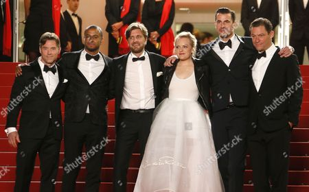Actor Christopher Laesso, British actor Dominic West, Swedish director Ruben Ostlund, US actress Elisabeth Moss, Dannish actor Claes Bang and US actor Terry Notary (C) arrive for the premiere of 'The Square' during the 70th annual Cannes Film Festival, in Cannes, France, 20 May 2017. The movie is presented in the Official Competition of the festival which runs from 17 to 28 May.