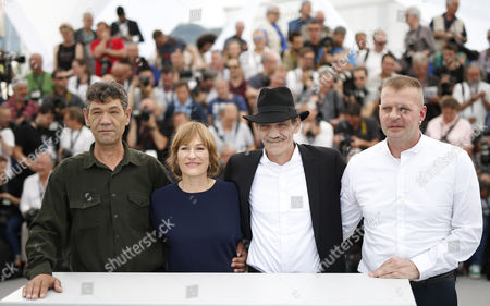 Stock Picture of (L-R) Actor Syuleyman Alilov Letifov, German director Valeska Grisebach, Actor Mainhard Neumann and Actor Reinhard Wetrek pose during the photocall for 'Western' at the 70th annual Cannes Film Festival, in Cannes, France, 18 May 2017. The movie is presented in the section Un Certain Regard of the festival which runs from 17 to 28 May.