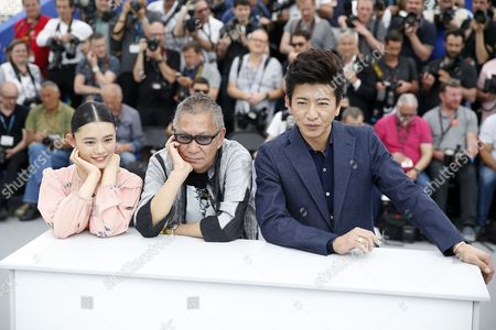 Japanese actress Hanna Sugisaki (L), Japanese director Takashi Miike (C) and Japanese actor Takuya Kimura poses during the photocall for 'Mugen No Junin' (Blade of the Immortal) at the 70th annual Cannes Film Festival, in Cannes, France, XX May 2017. The movie is presented out of competition at the festival which runs from 17 to 28 May.