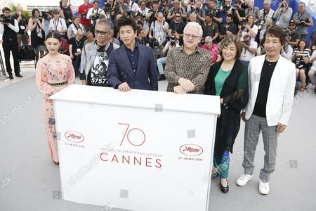 (L-R)Japanese actress Hanna Sugisaki, Japanese director Takashi Miike, Japanese actor Takuya Kimura with producers Jeremy Thomas,Misako Saka and Hiroyoshi Koiwai pose during the photocall for 'Mugen No Junin' (Blade of the Immortal) at the 70th annual Cannes Film Festival, in Cannes, France, XX May 2017. The movie is presented out of competition at the festival which runs from 17 to 28 May.