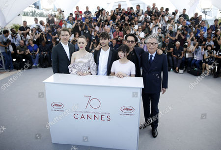 (L-R) US actor Paul Dano, British actress Lily Collins, Canadian actor Devon Bostick, South Korean actress Ahn Seo-Hyun, South Korean actor Yeun Steven and South Korean actor Byung Heebong attend the photocall for Okja during the 70th annual Cannes Film Festival, in Cannes, France, 19 May 2017. The movie is presented in the Official Competition of the festival which runs from 17 to 28 May.