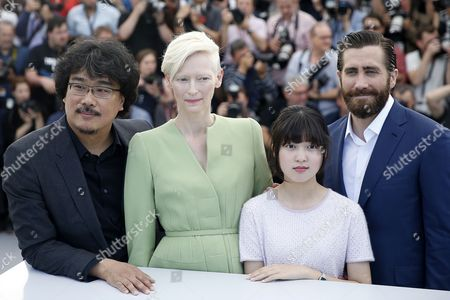 (L-R) South Korean director Bong Joon-ho, British actress Tilda Swinton, South Korean actress Ahn Seo-Hyun  and US actor Jake Gyllenhaal attend the photocall for Okja during the 70th annual Cannes Film Festival, in Cannes, France, 19 May 2017. The movie is presented in the Official Competition of the festival which runs from 17 to 28 May.