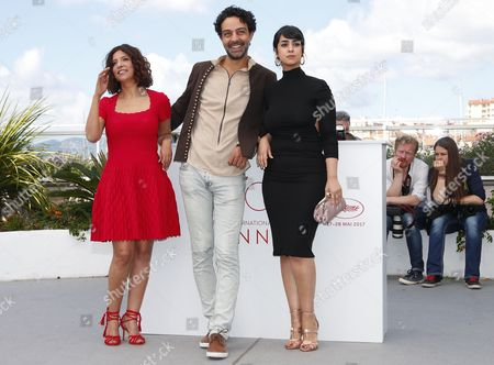 (L-R9 Tunisian director Kaouther Ben Hania, Actor Ghanem Zrelli and Actress Mariam Al Ferjani pose during the photocall for Aala Kaf Ifrit (Beauty and the Dogs) at the 70th annual Cannes Film Festival, in Cannes, France, 19 May 2017. The movie is presented in the section Un Certain Regard of the festival which runs from 17 to 28 May.