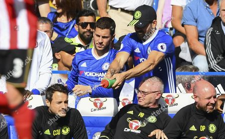 Diego Costa of Chelsea larks around on the bench before full time and sprays water on the head of Carlo Cudicini during the Premier League match between Chelsea and Sunderland played at Stamford Bridge, London on 21st May 2017