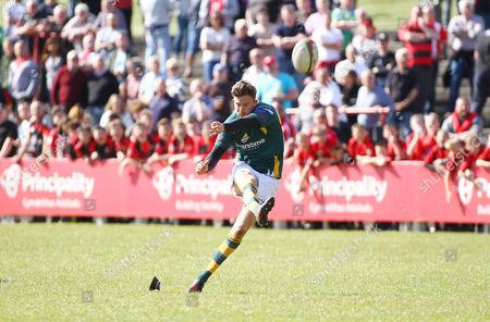 Matthew Jarvis of Merthyr kicks at goal