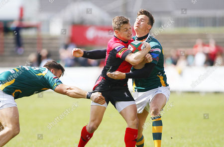 Stef Andrews of Aberavon is tackled by Arron Pinchers and Matthew Jarvis of Merthyr