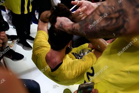 Fenerbahce's Pero Antic, right, cuts the hair of his teammate Luigi Datome after their victory at the Final Four Euroleague at Sinan Erdem Dome in Istanbul, . Fenerbahce won Olympiakos 80-64