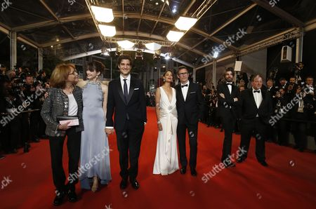 (L-R) French-British actress Stacy Martin, French director Michel Hazanavicius, French actress Berenice Bejo, French actor Louis Garrel, French actor Micha Lescot, French actor Gregoy Gadebois and guest arrive for the premiere of  'Le Redoutable' (Redoubtable) during the 70th annual Cannes Film Festival, in Cannes, France, 21 May 2017. The movie is presented in the Official Competition of the festival which runs from 17 to 28 May.