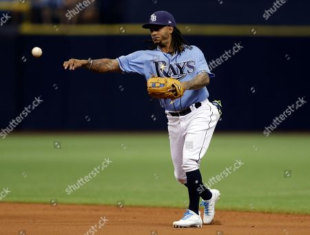 Tampa Bay Rays second baseman Michael Martinez throws out New York Yankees' Jacoby Ellsbury at first during the eighth inning of a baseball game, in St. Petersburg, Fla