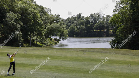 Sun Young Yoo takes her second shot from the 8th fairway during the final round of the Kingsmill Championship on the Kingsmill Resort River Course in Williamsburg, Virginia