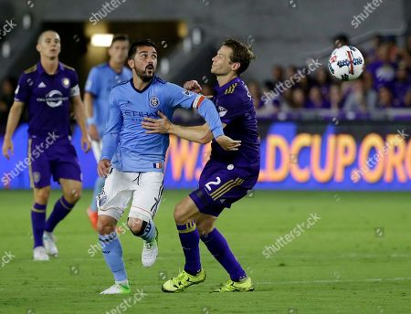 New York City FC's David Villa (7) and Orlando City's Jonathan Spector (2) go after the ball during the second half of an MLS soccer game, in Orlando, Fla. New York City FC won 3-0
