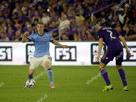 New York City FC's Alexander Ring, left, looks to pass the ball around Orlando City's Jonathan Spector (2) during the second half of an MLS soccer game, in Orlando, Fla. New York City FC won 3-0