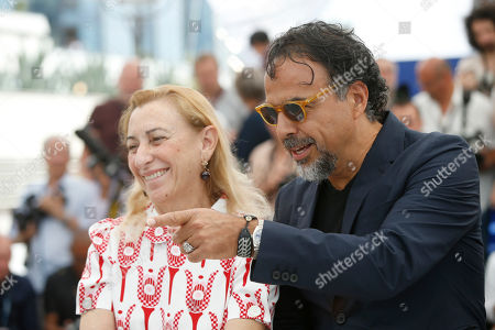 Director Alejandro G Inarritu, right, and Miuccia Prada pose for photographers during the photo call for the film Carne Y Arena at the 70th international film festival, Cannes, southern France