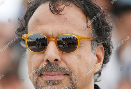 Director Alejandro G Inarritu poses for photographers during the photo call for the film Carne Y Arena at the 70th international film festival, Cannes, southern France