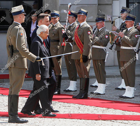 Andrzej Duda, Tony Tan Keng Yam President Andrzej Duda, rear, and President of Singapore Tony Tan Keng Yam attend a welcoming ceremony at the Presidential Palace in Warsaw, Poland