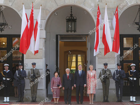 Andrzej Duda, Tony Tan Keng Yam, Agata Kornhauser-Duda, Mary Chee Bee Kiang Polish President Andrzej Duda, second right, with his wife Agata Kornhauser-Duda, right, and President of Singapore Tony Tan Keng Yam, second left, and his wife Mary Chee Bee Kiang, left, attend a welcoming ceremony at the Presidential Palace in Warsaw, Poland