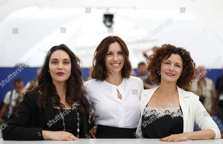 (L-R) French actress Hania Amar, French actress Aure Atika and Algerian actress Nadia Kaci poses during the photocall for 'En attendant les Hirondelles' (Until the Birds Return) at the 70th annual Cannes Film Festival, in Cannes, France