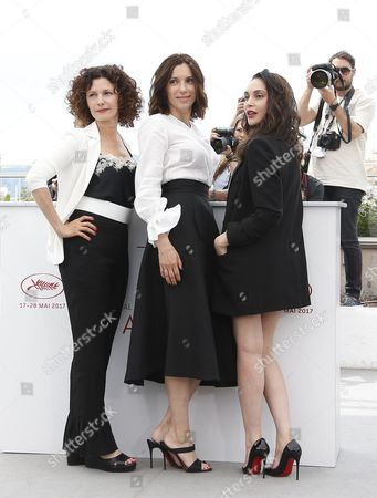 (R-L) French actress Hania Amar, French actress Aure Atika and Algerian actress Nadia Kaci poses during the photocall for 'En attendant les Hirondelles' (Until the Birds Return) at the 70th annual Cannes Film Festival, in Cannes, France