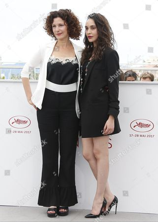 Stock Picture of Hania Amar (R) and Algerian actress Nadia Kaci poses during the photocall for 'En attendant les Hirondelles' (Until the Birds Return) at the 70th annual Cannes Film Festival, in Cannes, France
