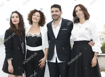 Stock Photo of (R-L) French actress Hania Amar, Algerian director Karim Moussaoui,  French actress Aure Atika and Algerian actress Nadia Kaci poses during the photocall for 'En attendant les Hirondelles' (Until the Birds Return) at the 70th annual Cannes Film Festival, in Cannes, France