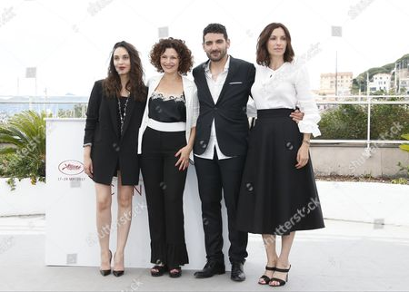 Stock Image of (R-L) French actress Hania Amar, Algerian director Karim Moussaoui,  French actress Aure Atika and Algerian actress Nadia Kaci poses during the photocall for 'En attendant les Hirondelles' (Until the Birds Return) at the 70th annual Cannes Film Festival, in Cannes, France