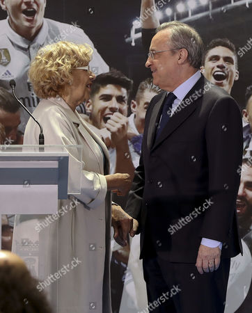 Madrid's Mayoress, Manuela Carmena (L), greets Real Madrid's president, Florentino Fernandez (R), during a reception of Real Madrid at the Town Hall in Madrid, Spain, 22 May 2017. Real Madrid celebrate their 33rd Spanish league title.