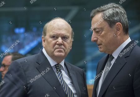 Stock Image of Irish Finance Minister Michael Noonan (L) and President of the European Central Bank (ECB) Mario Draghi prior to the start of a Eurogroup Finance Ministers' meeting at the EU Council, in Brussels, Belgium, 22 May 2017.