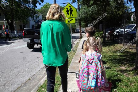 """Stock Photo of Joanna Smith, of Houston, walks her twin first-graders home from school. One of her children is transgender and Smith fears the child's school would be compelled by the state to """"out"""" her child's biological gender should a """"bathroom bill"""" become law"""