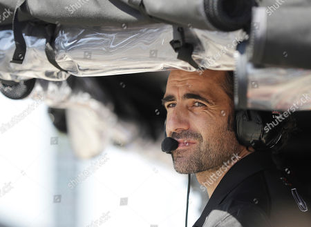 Three-time Indy 500 champion Dario Franchitti, of Scotland, watches from the pit box of Scott Dixon, of New Zealand, during practice for the Indianapolis 500 IndyCar auto race at Indianapolis Motor Speedway, in Indianapolis