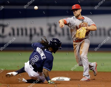 Stock Picture of Nolan Fontana, Michael Martinez Los Angeles Angels second baseman Nolan Fontana forces Tampa Bay Rays' Michael Martinez at second base and throws to first in time to turn a double play on Derek Norris during the fifth inning of a baseball game, in St. Petersburg, Fla