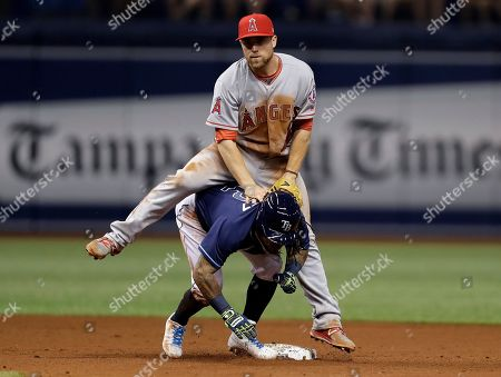 Los Angeles Angels second baseman Nolan Fontana lands on Tampa Bay Rays' Michael Martinez after turning a double play during the fifth inning of a baseball game, in St. Petersburg, Fla