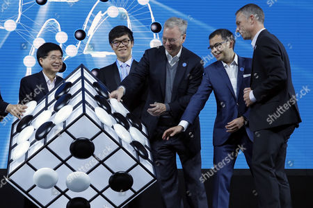 Chinese Go player Ke Jie (2-L), Alphabet executive chairman Eric Schmidt (3-L) ,Demis Hassabis (2-R), co-founder of Google's artificial intelligence (AI) startup DeepMind and Scott Beaumont (R), President of Google Greater China, attend the opening ceremony of the Future of Go summit ahead of a match between Ke Jie and Google's artificial intelligence program AlphaGo at Wuzhen internet international conference and exhibition center in Wuzhen, China's Zhejiang province, 23 May 2017. The summit is held from 23 to 27 May in Wuzhen.