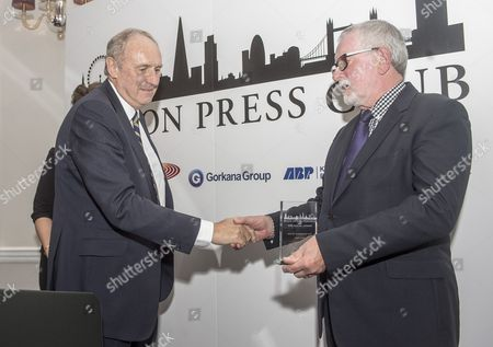 Stock Photo of Paul Dacre. Daily Mail Editor-in-chief Paul Dacre Receiving An Award For Daily Newspaper Of The Year At The Annual London Press Club Awards Ceremony. 5/4/2016 Paul Dacre Receiving The Award From Chair Of Judges Bill Hagerty.