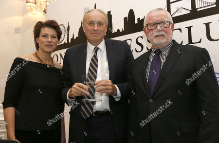 Editorial photo of Daily Mail Editor In Chief Paul Dacre Receiving An Award For Daily Newspaper Of The Year From Chair Of Judges Bill Hagerty And Tv Presenter Kate Silverton At The London Press Club Annual Awards Ceremony. Picture David Parker 5/4/2016.