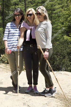 L-r: Sophie Agnew Amanda Cook Tucker Natasha Archer 15.04.16 Palace Staff Hike Ahead Of The Duke And Duchess Of Cambridge To Paro Taktsang The Tiger's Nest Monastery Which Dates Back To 1692 At The Half Way Stage They Spin The Prayer Wheels During Their Two Day Stay In Bhutan.