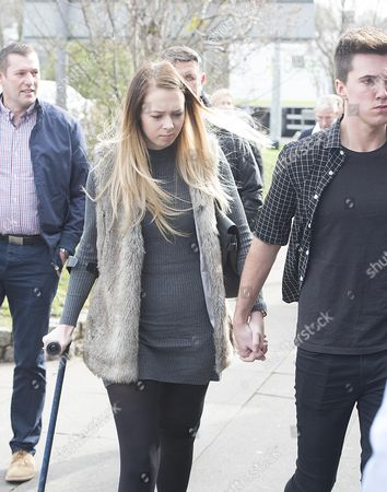 Leah Washington One Of The Victims Of The Rollercoaster Crash Arrives At Court With Boyfriend Joe Pugh. Court Case Involving The Owners Of Alton Towers Who Have Admitted Health And Safety Breaches Over The Smiler Rollercoaster Crash Which Resulted In Two Women Losing A Leg And Left Three More Theme Park Goers Badly Injured. Merlin Attractions Operations Ltd Who Own Alton Towers Now Faces Paying A Fine That Could Stretch Into Millions After Pleading Guilty To The Rule Breach At North Staffordshire Justice Centre In Newcastle-under-lyme.