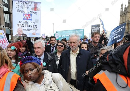 Jeremy Corbyn And John Mcdonnell Join The Junior Doctors As They March From St Thomas's Hospital Past Westminster To The Department Of Health In Protest Of The New Contracts Being Imposed Upon Them. 2016/04/26.