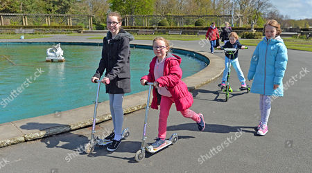 Stock Picture of Parents Remove Their Children From School Across The UK In A Day Of Action Against Children Being Over-tested In The School System. (l To R) Grace Bennett 10 Megan Bennett 7 Isobel Walsh 7 And Abbie Walsh 9 Scoot Around Stanley Park Blackpool Lancs. With Their Mums On Their Day Off From Attending School. - 3/5/16.