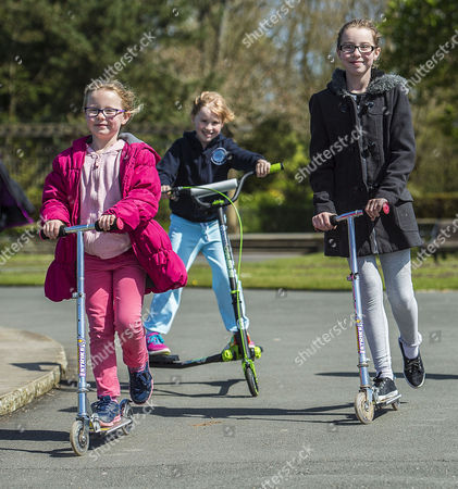 Editorial picture of Parents Remove Their Children From School Across The Uk In A Day Of Action Against Children Being Over-tested In The School System. (l To R) Megan Bennett 7 Isobel Walsh 7 And Grace Bennett 10 Scoot Around Stanley Park Blackpool Lancs. On Their Day O