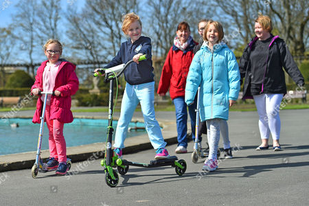Editorial image of Parents Remove Their Children From School Across The Uk In A Day Of Action Against Children Being Over-tested In The School System. (l To R) Megan Bennett 7 Isobel Walsh 7 And Abbie Walsh 9 With Their Parents Zoe Walsh(red Jacket) And Lyndsey Bennett