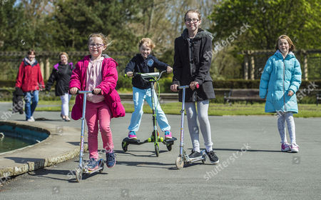 Editorial photo of Parents Remove Their Children From School Across The Uk In A Day Of Action Against Children Being Over-tested In The School System. (l To R) Megan Bennett 7 Isobel Walsh 7 Grace Bennett 10 And Abbie Walsh 9 Scoot Around Stanley Park Blackpool Lancs.