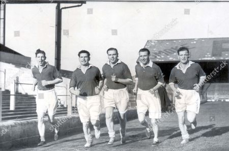 Football : Training.... 1949 A Training Sprint For Welsh Internationals Powell Shrott Griffiths And Alf Sherwood Who Will Play Against The Belgians. Roy Clarke (died March 2006) Is On The Extreme Left.