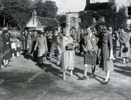 Queen Elizabeth (queen Mother) September 1948 Queen Elizabeth Visits Community Centre In Craigston Castle. Her Majesty Escorted By Mr. Bruce Urquhart Is Seen Walking Through The Grounds Of The Castle....royalty