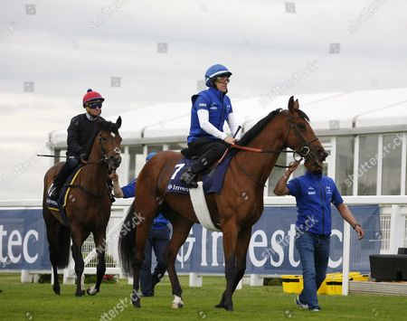 Kidmenever (Willie Ryan in blue up) and Best of Days (Michael Hills up) at the iconic Breakfast with the Stars preview of the world famous Classic Derby horse race on the Downs above the town.