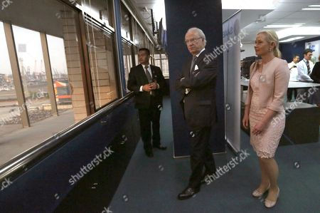 King Carl XVI Gustaf of Sweden, center, and Swedish Minister of Infrastructure Anna Johansson, right, inspect the facility during their visit at the Vessel Traffic Center at Tanjung Priok Port in Jakarta, Indonesia, . The King and his wife Queen Silvia is currently on a three-day state visit in Indonesia