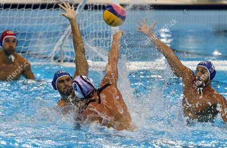 Stock Photo of Niccolo Gitto (2-l) of Italy in Action Against Tony Azevedo (2-r) of the Usa During the Men's Water Polo Preliminary Round Game Between the Usa and Italy at the Rio 2016 Olympic Games at the Olympic Aquatics Stadium in the Olympic Park in Rio De Janeiro Brazil 14 August 2016 Brazil Rio De Janeiro