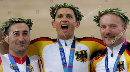 Germany's Michael Teuber (c - Gold) Spain's Juanjo Mendez (l - Silver) and German Peter Hans Beier (r- Bronze) Celebrate Their Victory Men's Lc4 Bicycle 4km Individual Pursuit in the Athens Central Olympic Complex Velodrome on Sunday 19 September 2004 For the Athens 2004 Paralympic Games Greece Athens